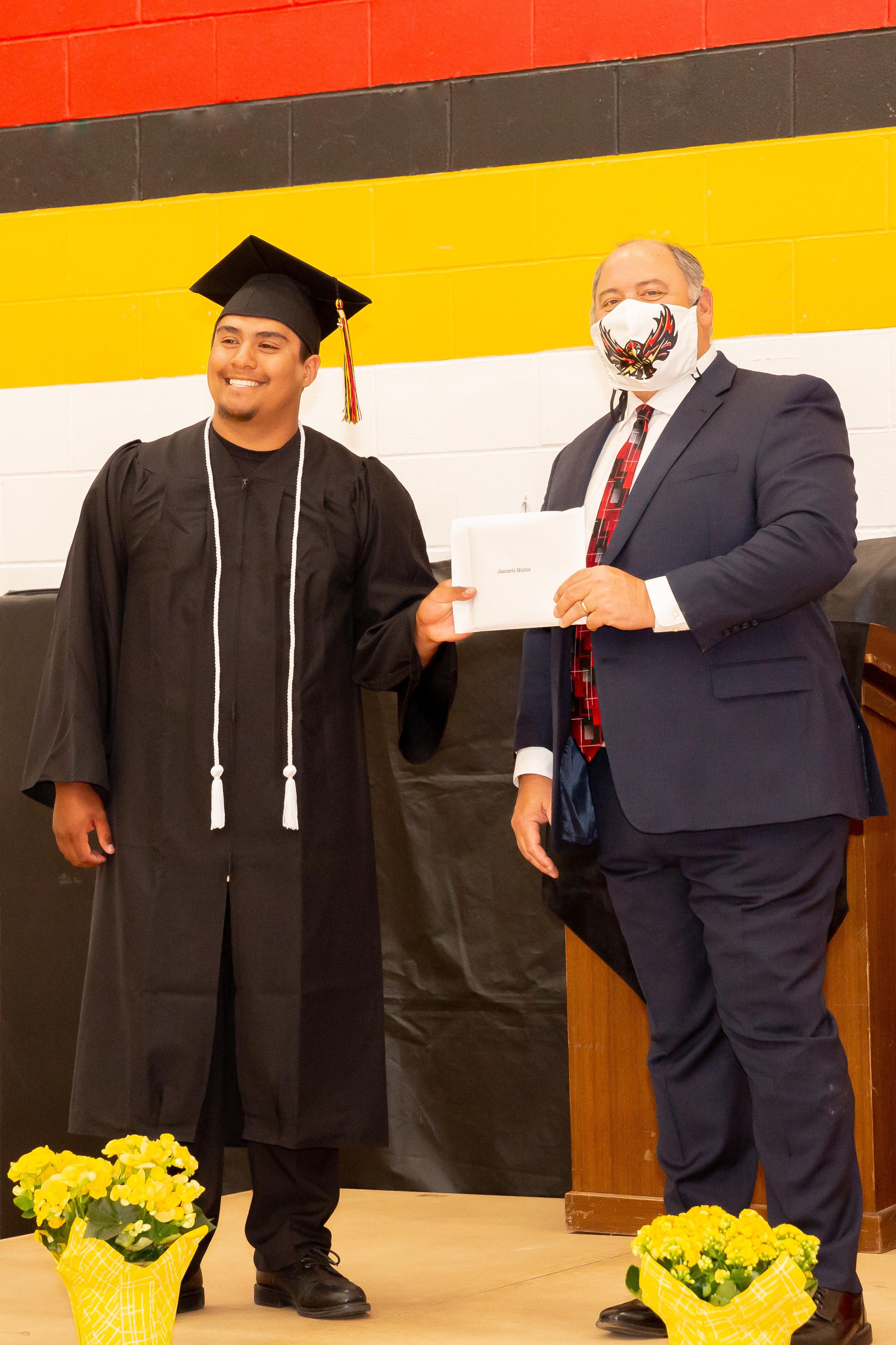 JC Munoz receives his diploma.