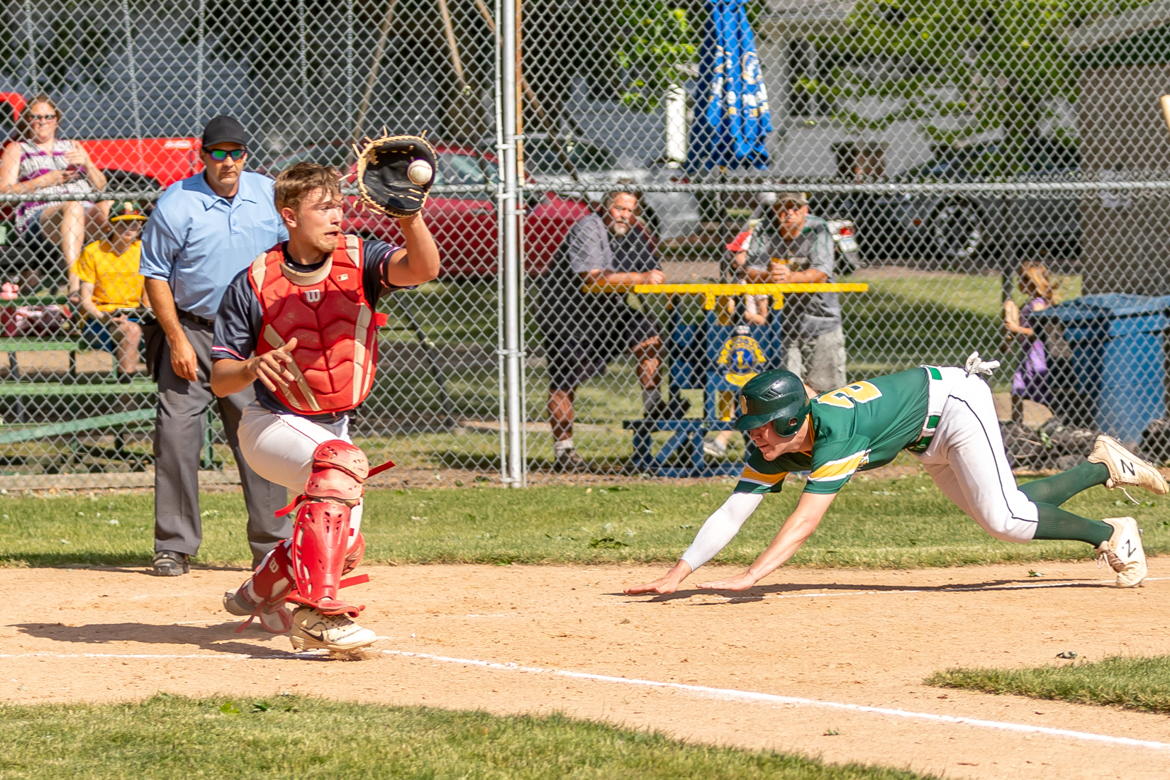 Catcher Ethan Schwarzrock does his best to beat the runner.
