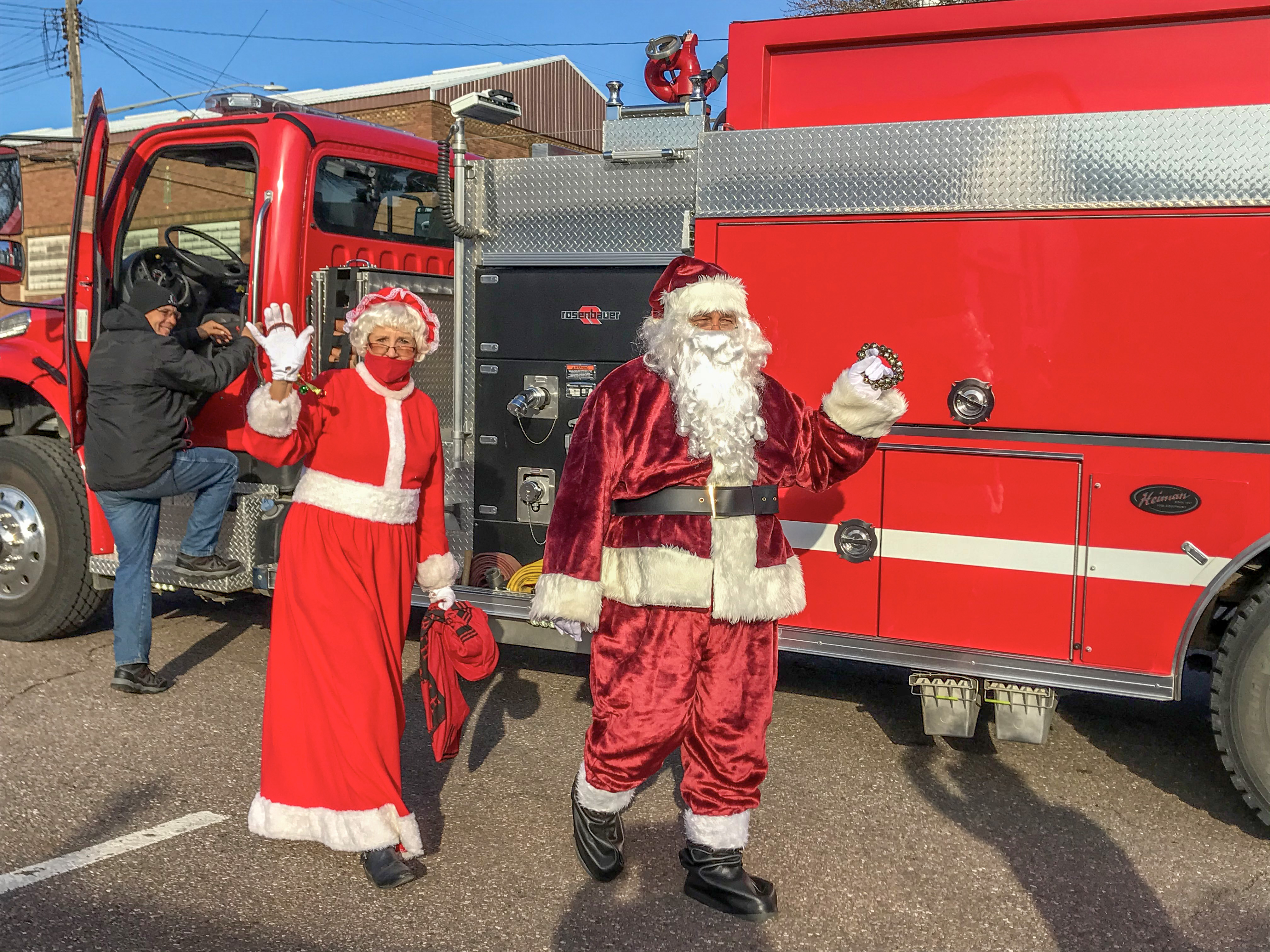 The Claus' arrive on a Gibbon Fire Truck