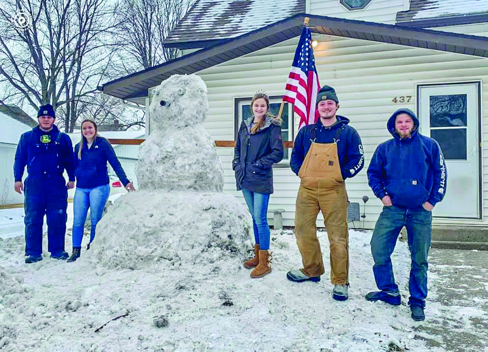 The Snow Sculpture Contest had some great entries this year.  Gibbon Royalty Rylee Sabo and Baleigh Peterson are pictured with the various creations. This sculpture was the first place winner.