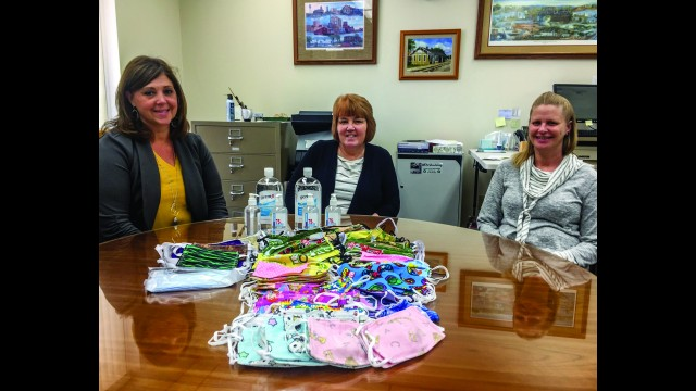 Frandsen Bank staff members (from left) Karen Bastian, Theresa Grunke and Lori Wendinger are pictured with some of the personal protective equipment they've collected for local schools. (Submitted photo)