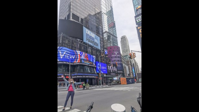Gibbon native Megan Hillmann stands in an empty Times Square in New York City during a recent trip to help treat COVID-19 patients there.  (Submitted photo)
