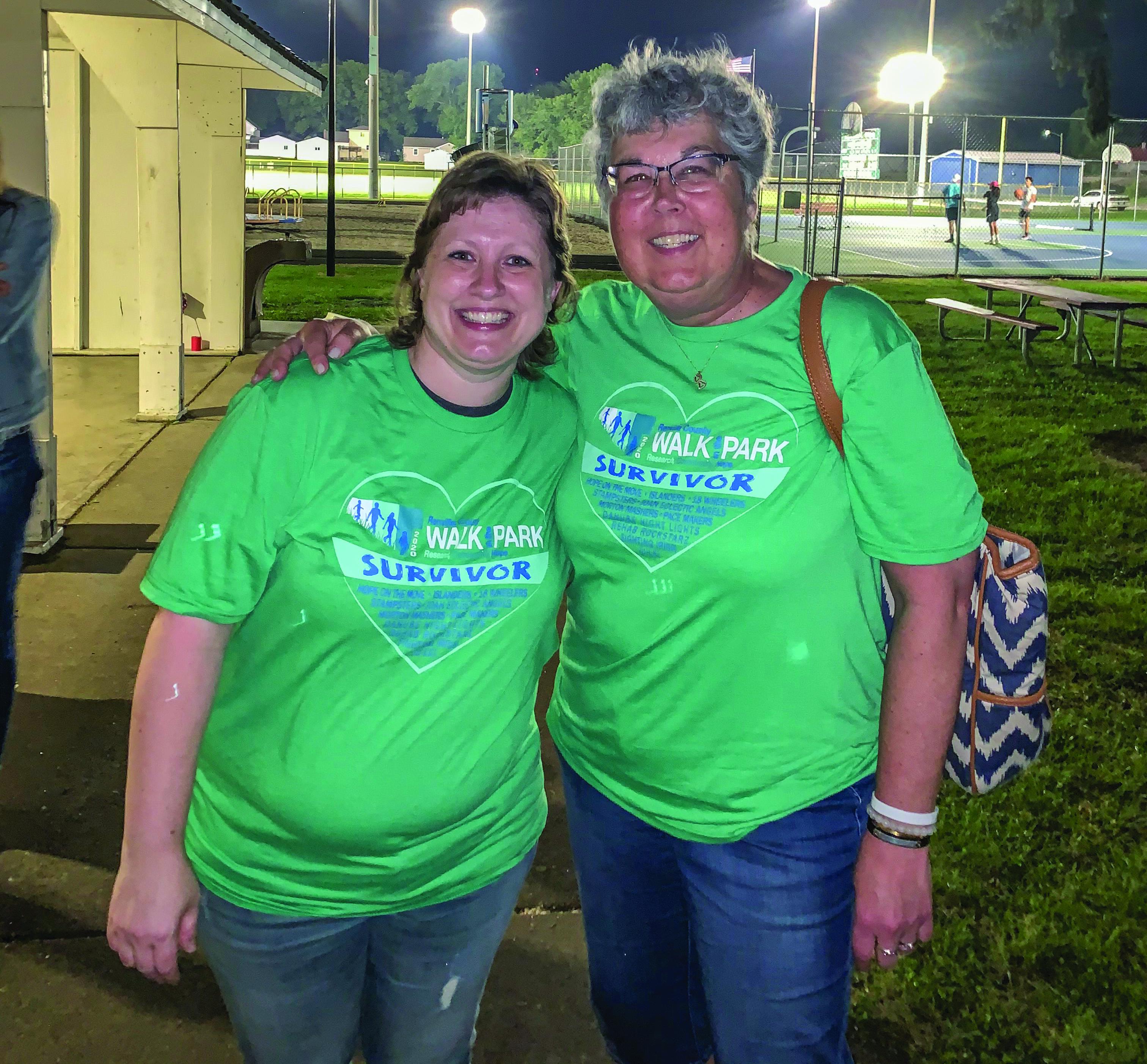 Survivors Kim Kaiser and Maria Cuff take a break from the walk for a photo.