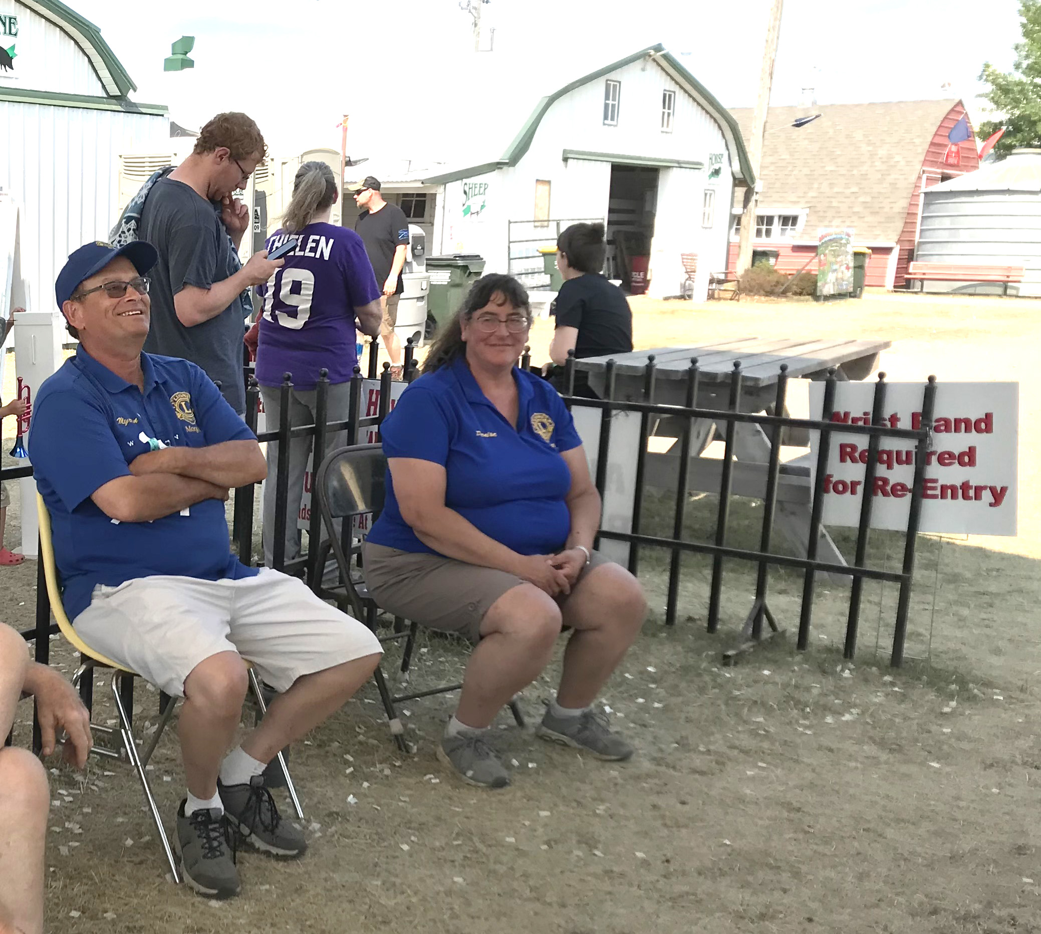 Myron Mathiowetz (left) Denise Nelsen (right), members of the Morgan Lions Club, worked the gate Sunday at the Redwood County Fair.