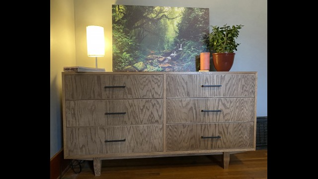 Pictured are two of the pieces Dalluge has created – a storage bench (above), and a six-drawer dresser (below) in the mid-century modern style she favors. (Submitted photos)
