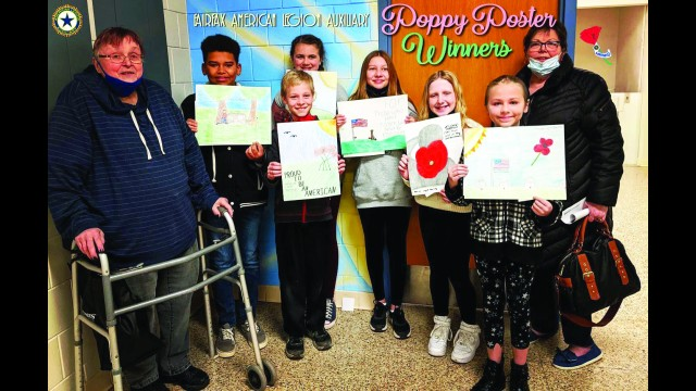 Pictured are this year's Poppy Poster winners along with members of the Fairfax American Legion Auxiliary (from left) Unit President Dawn Bleick, Terrell Stearns, Isaac Vos, Annie Wersal, Kjerssa Jasinski, Claire Messerli, Ahnika Prafke and Second Vice and Poppy Chair Marijo Minter. (Submitted photo)